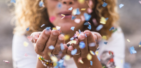 life after divorce – woman blowing confetti from her hands image