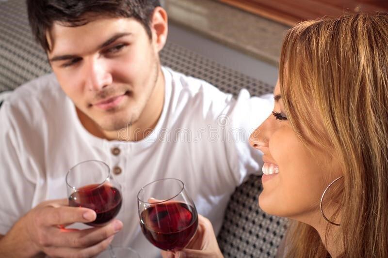 – Happy couple drinking wine image